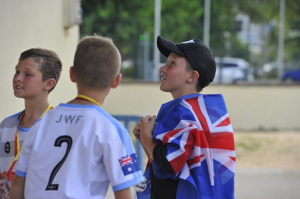 IberCup Barcelona - boy with the English flag - Road to Sport