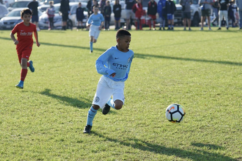 IberCup USA - young player on the ground - Road to Sport