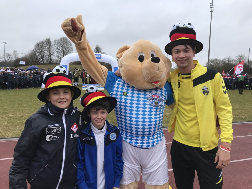 Bayern Soccer Cup - young participants with the mascot - Road to Sport