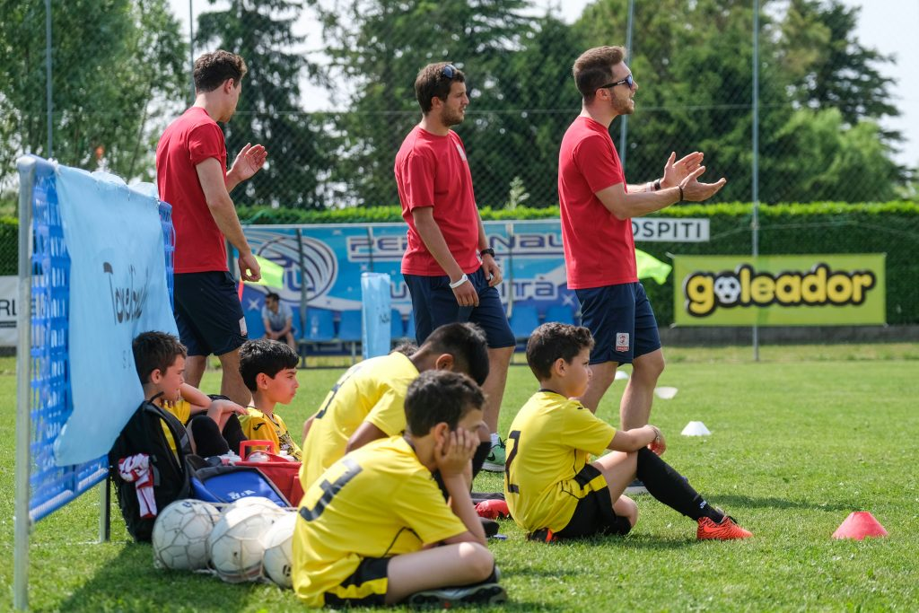 Summer Village Cup - players sitting on the grass - Road to Sport